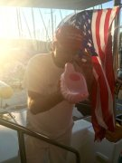 Edi flabongo-ing with a Trump hat and American flag...